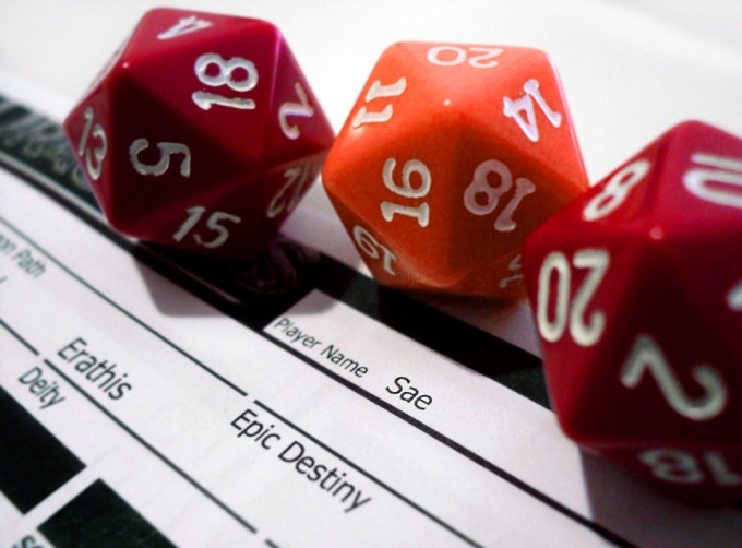 three dice on a character sheet