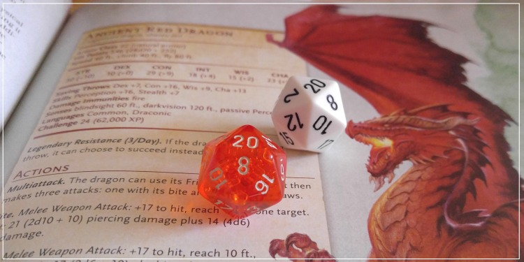 two dice on a monster manual page